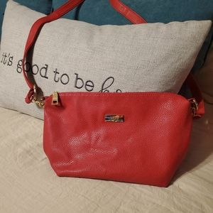 Medium size red faux leather bag